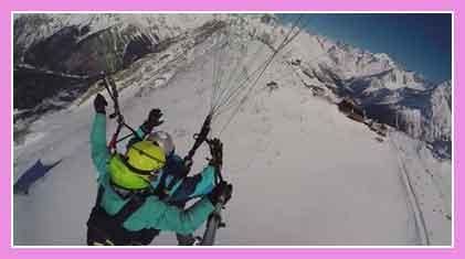 горнолыжники на дельтаплане